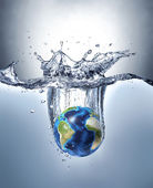 Planet Earth, splashing into water.  — Stock Photo