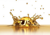 Liquid gold spash — Stock Photo