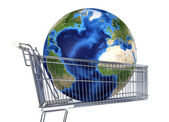 Planet Earth into supermarket trolley. — Stock Photo