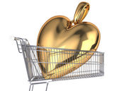 Supermarket trolley with  gold heart — Stock Photo