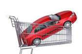 Supermarket trolley with red car — Stock Photo