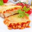 Baked beans on toast - Stock Photo