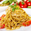 Spaghetti with basil pesto — Stock Photo