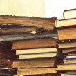 Many vintage old dirty books in three stack - Stock Photo