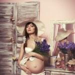 Beautiful pregnant girl in interior — Stock Photo