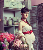 Beautiful pregnant girl in interior — Stock Photo