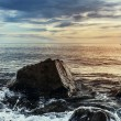 Large stone on a background of sea sunset — Foto de Stock