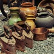 Old iron and jugs at a flea market — Stock Photo #43978585