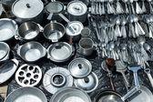Aluminum cookware for sale at a flea market — Stock Photo