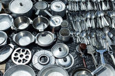 Aluminum cookware for sale at a flea market — Stock Photo