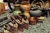 Old iron and jugs at a flea market — Stock Photo