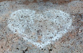 Sign as a heart drawn in chalk on the stone — Stock Photo