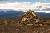Pyramid of stones on a background big mountain — Stock Photo