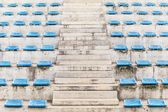 Stairway corridor grandstand arena with blue chair — Stock Photo