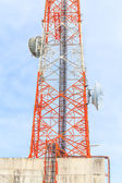 Building with tower antenna radio — Stockfoto