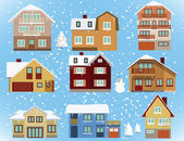 Verschneite Häuser — Stockvektor