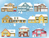Snow covered city houses — Stock Vector