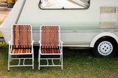 Chair and camping car — Stock Photo
