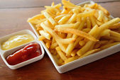 Golden French fries potatoes ready to be eaten — Stock Photo