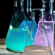 Volumetric laboratory glassware containing colored liquids — Stock Photo #38320645