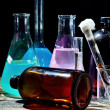 Volumetric laboratory glassware containing colored liquids — Stock Photo #38320649