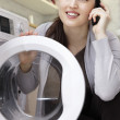 Caucasian woman doing laundry — Stock Photo