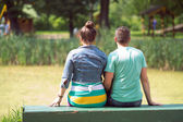 Loving couple on a bench — Stock Photo