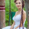 Bride on swing — Stock Photo #35205173