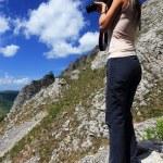 Girl taking nature photos — Stock Photo #25692301