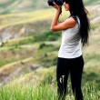 Young brown haired woman photographing — Stock Photo #25764349