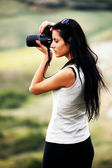 Young brown haired woman photographing — Stock Photo