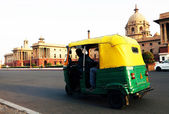 Auto rickshaw taxis on a road — Stock Photo