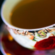 Decorated tea cup — Stock Photo