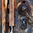 Frozen vintage lock of a wooden door — Stock Photo