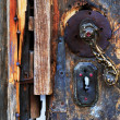 Frozen vintage lock of a wooden door - Stock Photo