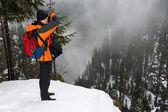 Climber photographs forest — Stock Photo
