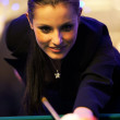 Young girl playing snooker — Stock Photo