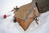 Alpine refuge covered by snow — Stock Photo
