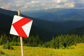 Curve road sign on an alpine road — Stock Photo