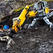 Excavator standing in the mud - Stock Photo
