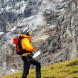 Alpinist contemplating Eiger Peak, Switzerland — Stock Photo