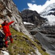 Alpinists contemplating the Eiger Glacier, Switzerland — Stockfoto
