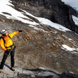 Alpinist contemplating the Eiger Glacier, Switzerland — Stock Photo