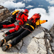 Alpinists contemplating the abyss — Stockfoto
