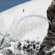 Paragliding over a glacier in the Swiss Alps — Stock Photo #26003751