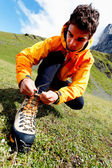 Alpinist preparing for climbing — Stock Photo
