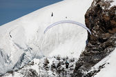 Paragliding over a glacier in the Swiss Alps — Stock Photo