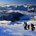 Alpinists climbing Elbrus — Stock Photo #26049907