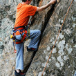 Stock Photo: Climbing alpinist