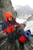 Climbing alpinist — Stock Photo